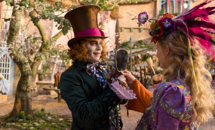 "FILE - In this image released by Disney, Johnny Depp, left, and Mia Wasikowska appear in a scene from ""Alice Through The Looking Glass."" (Peter Mountain/Disney via AP, File)"