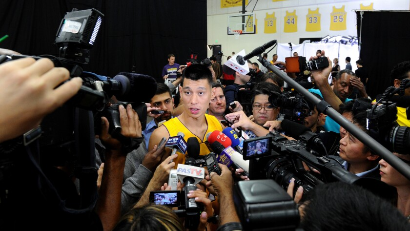 Lakers guard Jeremy Lin answers questions from reporters during the team's media day in El Segundo on Sept. 29.