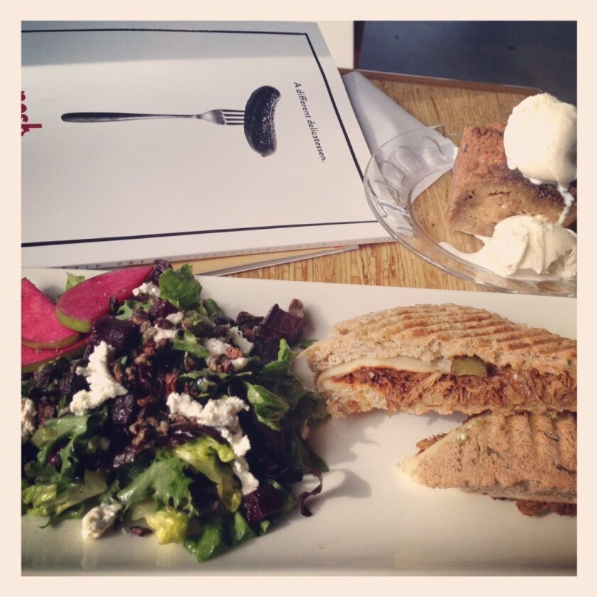 Panini, salad and bread pudding will all be delivered to your table at once, at Eclipse Chocolate Bar & Bistro.