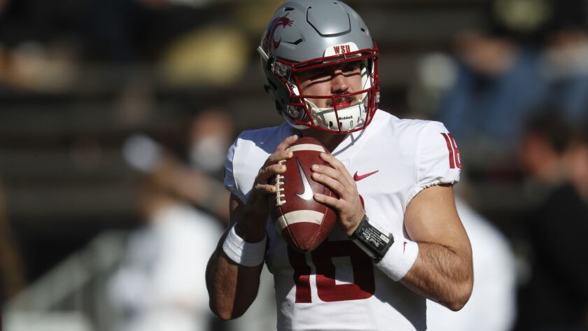 Washington State quarterback Gardner Minshew warms up before the first half against Colorado on Saturday.