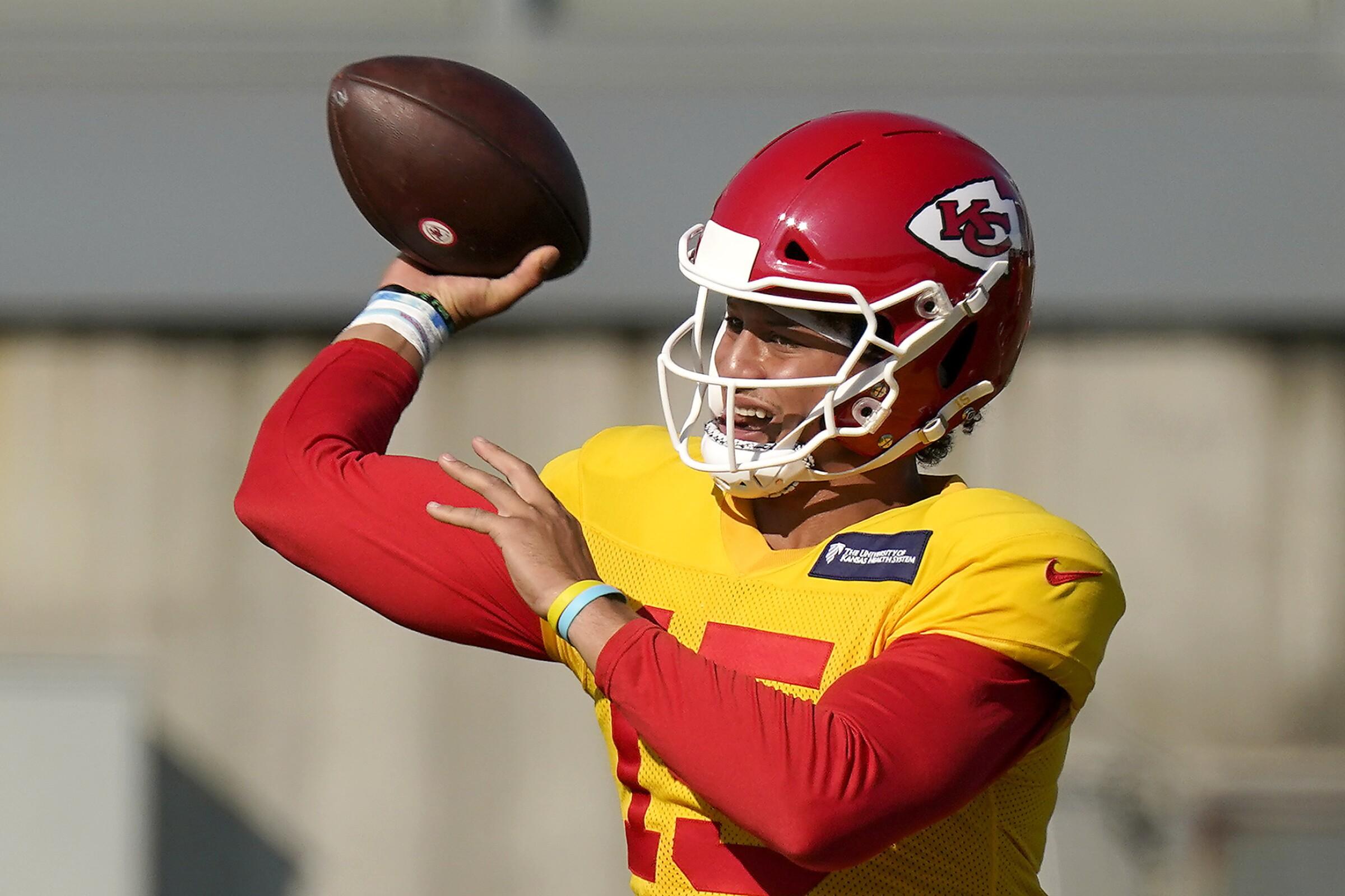Kansas City Chiefs quarterback Patrick Mahomes passes during an NFL football training camp.