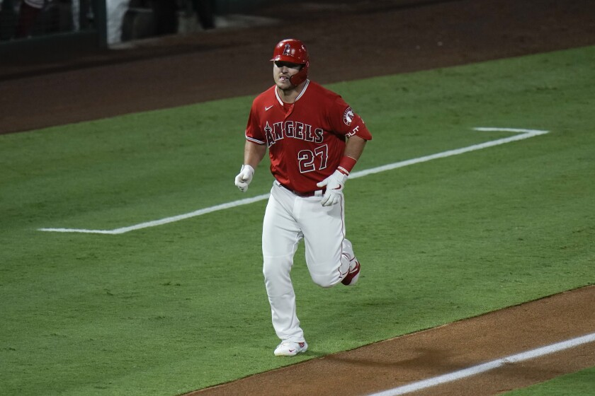 Angels' Mike Trout rounds the bases after hitting a two-run home run against the San Diego Padres on Sept. 2.