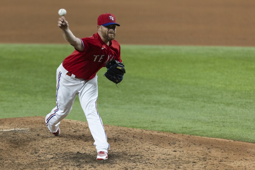 Texas Rangers relief pitcher Ian Kennedy throws during the ninth inning of the team's baseball game against the Tampa Bay Rays in Arlington, Texas, Friday, June 4, 2021. (AP Photo/Andy Jacobsohn)