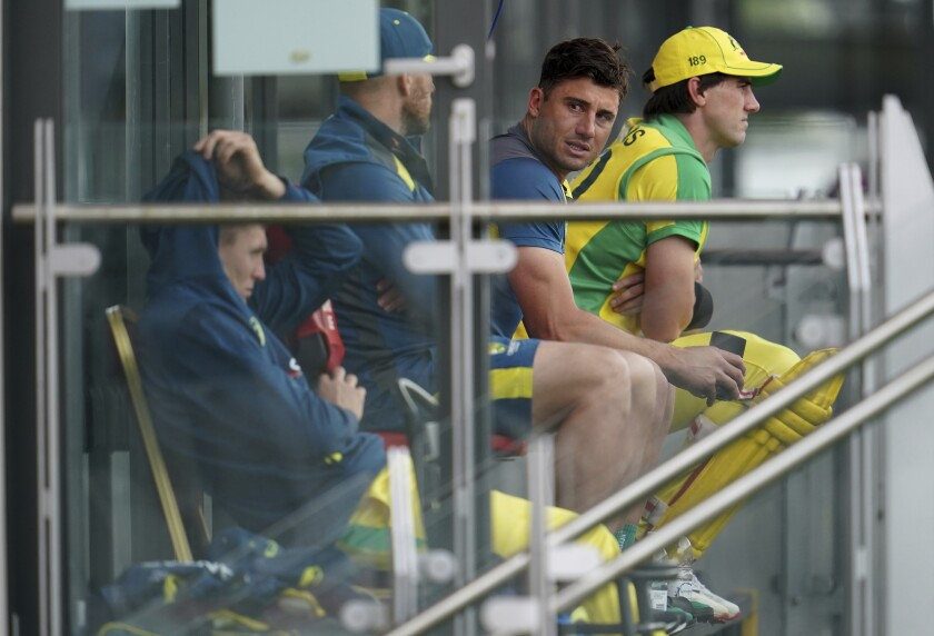 Australia's Marcus Stoinis, second right, sits with the teammates in the balcony as they watch the game during the first ODI cricket match between England and Australia, at Old Trafford in Manchester, England, Friday, Sept. 11, 2020. (AP Photo/Jon Super, Pool)