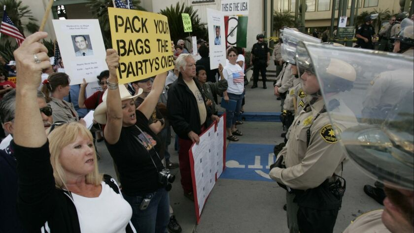 Protesters and police in front of Escondido City Hall in 2006 when tensions were high regarding an immigration issue.