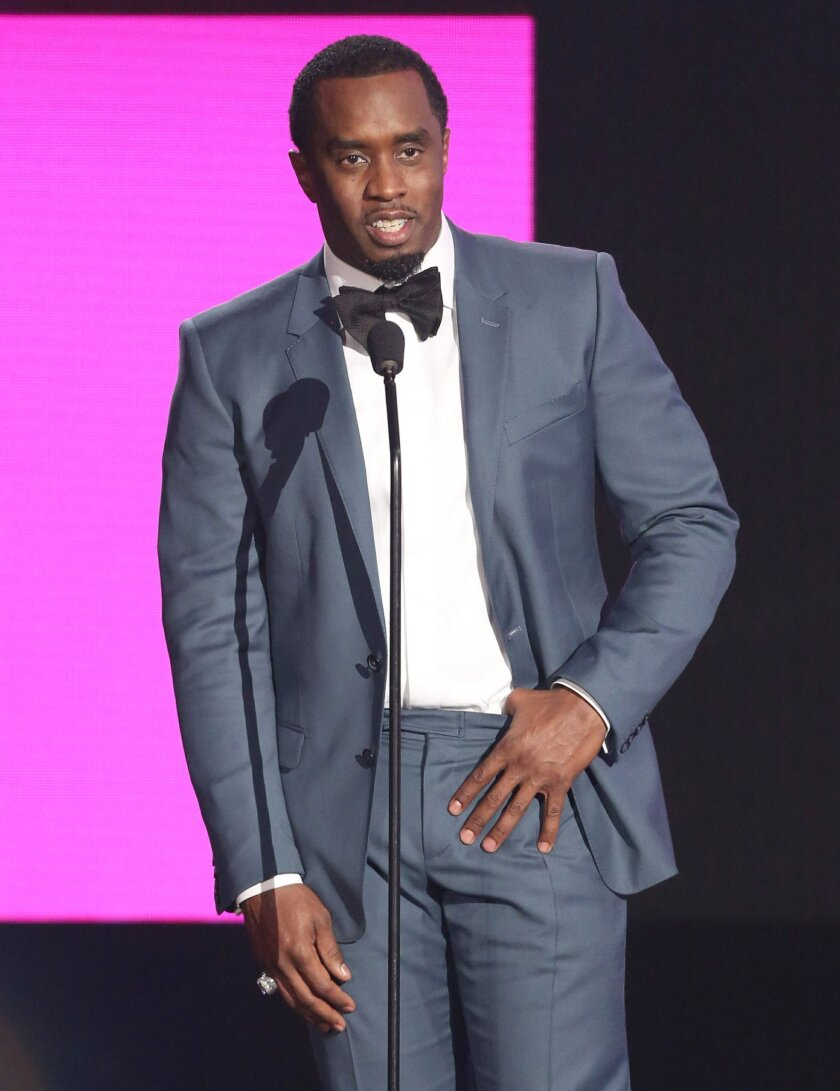 """CORRECTS ANNOUNCEMENT TO MONDAY, JAN. 25, FROM FRIDAY, JAN. 22 - FILE - In this Nov. 22, 2015 file photo, Sean """"Diddy"""" Combs presents the award for best collaboration of the year at the American Music Awards at the Microsoft Theater in Los Angeles. A bottled water company owned by Combs and Mark Wahlberg is pledging to donate 1 million bottles of water to the residents of Flint, Mich. AQUAhydrate said Monday, Jan. 25, 2016, it was sending 5,000 cases of water to Flint and would continue to provide bottles to residents until the town's water problems are solved. (Photo by Matt Sayles/Invision/AP, File)"""