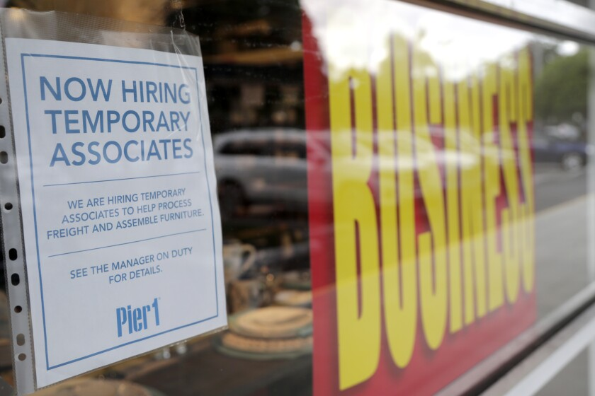A sign advertises hiring of temporary associates at Pier 1