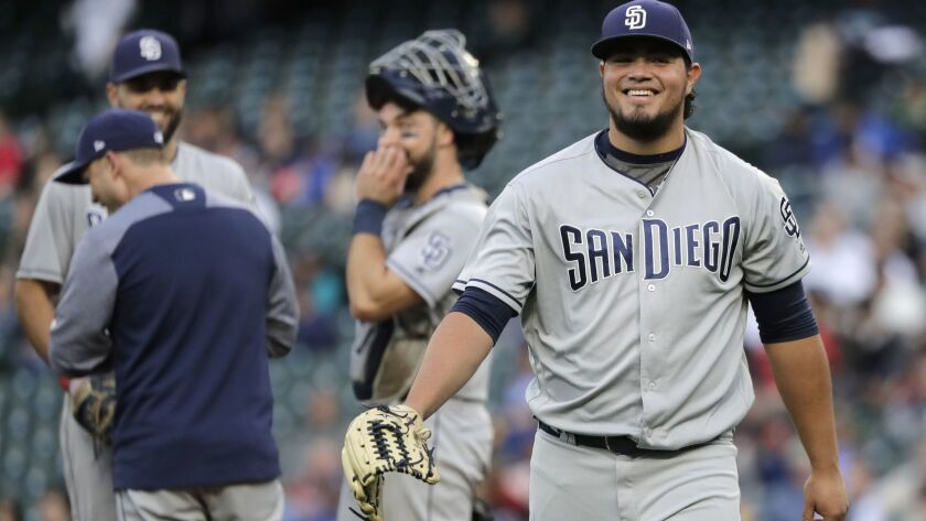 San Diego Padres pitcher Jose Castillo, right, smiles after he was pulled during the eighth inning o