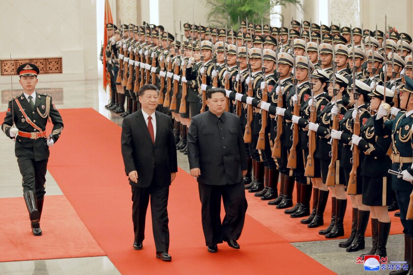 North Korean leader Kim Jong Un, right, and Chinese counterpart Xi Jinping inspect the honor guard at the Great Hall of the People in Beijing.