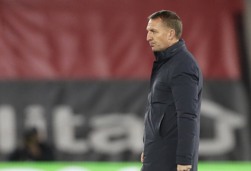 Leicester's head coach Brendan Rodgers walks on the pitch at the end of the English Premier League soccer match between Southampton and Leicester City at St. Mary's Stadium in Southampton, England, Friday, April 30, 2021. (AP Photo/Kirsty Wigglesworth, Pool)