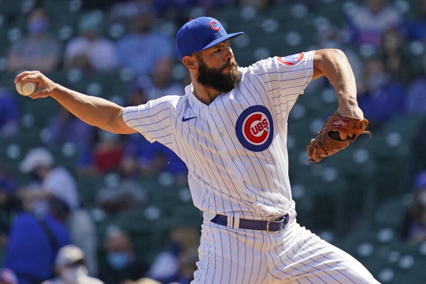 Chicago Cubs starting pitcher Jake Arrieta throws against the Pittsburgh Pirates during the first inning of a baseball game in Chicago, Saturday, April 3, 2021. (AP Photo/Nam Y. Huh)