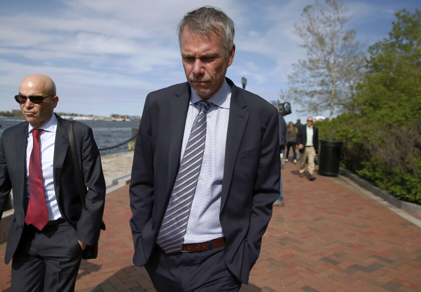 In this May 22, 2019 file photo, Jan Sartorio leaves federal court in Boston after pleading guilty to charges in a nationwide college admissions bribery scandal. Sartorio was sentenced on Friday to one year of probation.