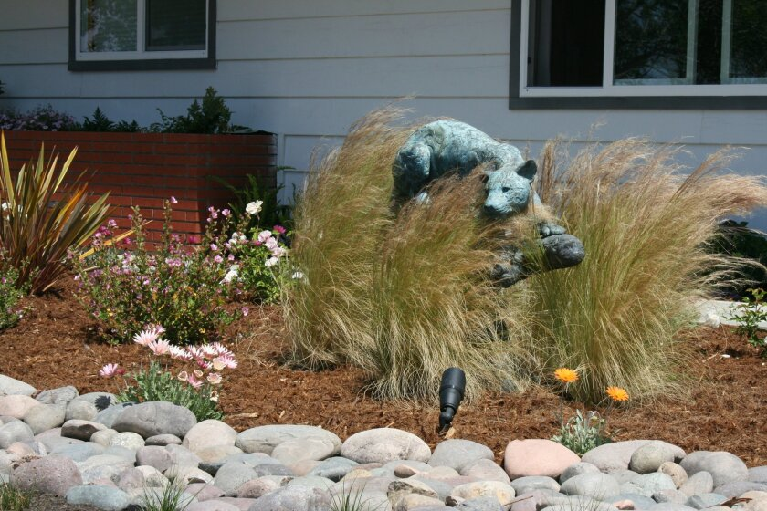 Belle Terre Landscapes' winning project used animal statues collected from the homeowners' travels.