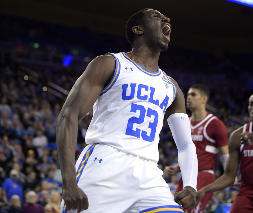 UCLA guard Prince Ali celebrates after a dunk during a game against Stanford last season.