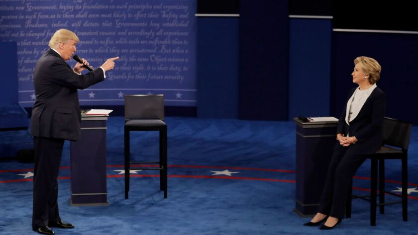 Republican nominee Donald Trump speaks to Democratic nominee Hillary Clinton during a 2016 presidential debate.