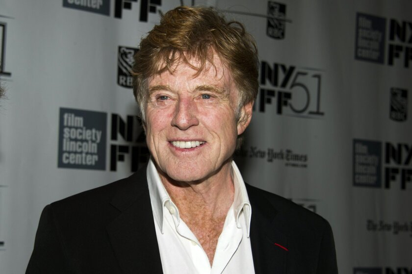 """FILE - This Oct. 8, 2013 file photo shows actor Robert Redford at the New York Film Festival screening of """"All Is Lost"""" in New York. Redford was nominated for a Golden Globe for best actor in a motion picture drama for his role in the film on Thursday, Dec. 12, 2013. (Photo by Charles Sykes/Invision/AP, File)"""