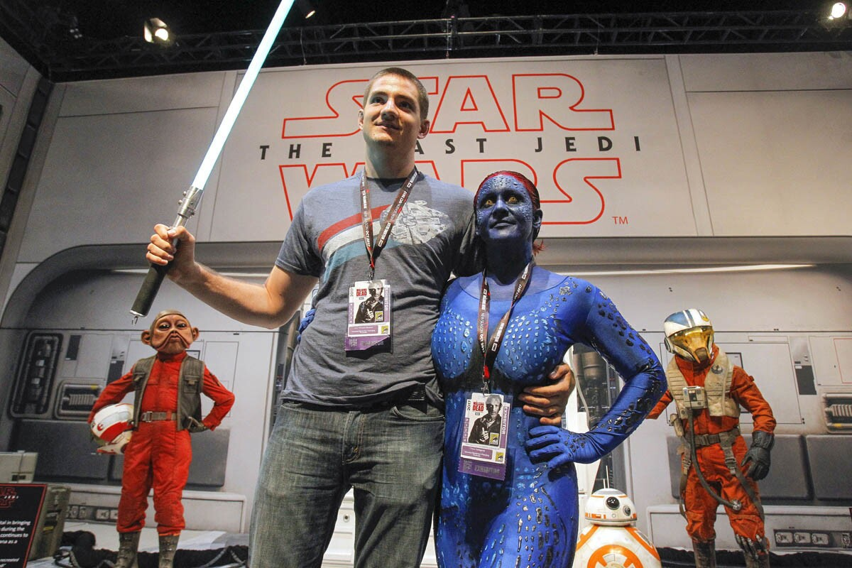 SAN DIEGO, July 19, 2017 | Crystal Cartagena, who is made up as Mystique from X-Men, which she did herself, and Chris Hering, takes their turn to pose for a photo at the Star Wars booth during Comic-Con International's Preview Night at the San Diego Convention Center in San Diego on Wednesday. | Photo by Hayne Palmour IV/San Diego Union-Tribune/Mandatory Credit: HAYNE PALMOUR IV/SAN DIEGO UNION-TRIBUNE/ZUMA PRESS San Diego Union-Tribune Photo by Hayne Palmour IV copyright 2017