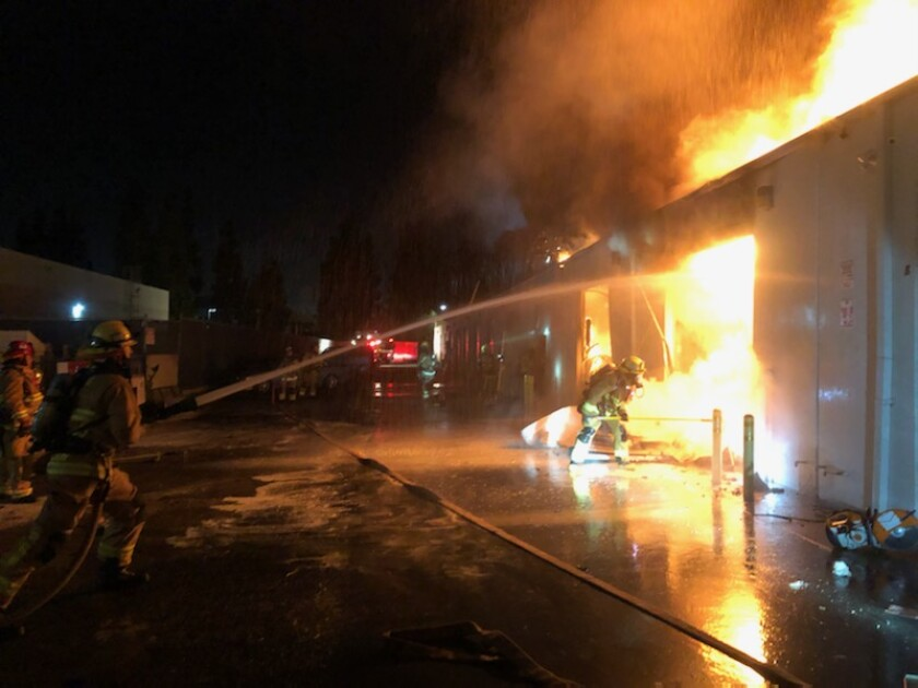 Costa Mesa firefighters doused a blaze that broke out early Tuesday at a commercial building on MacArthur Boulevard.