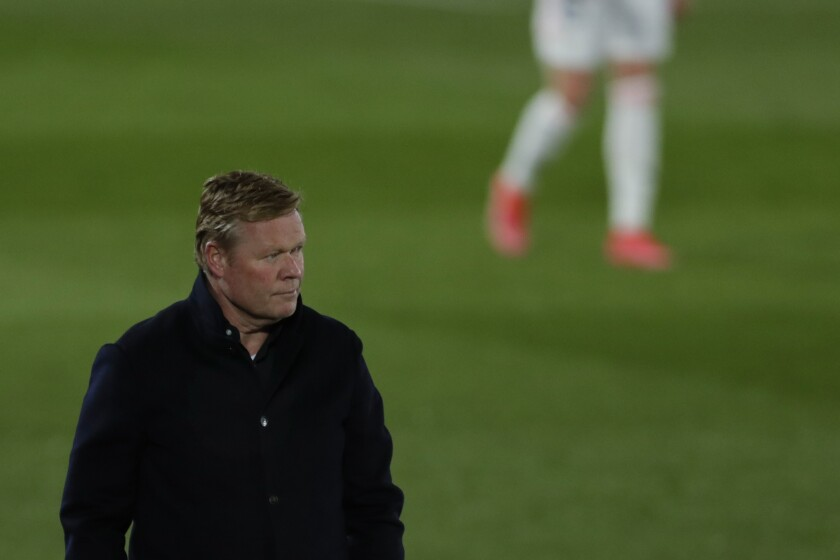 Barcelona's head coach Ronald Koeman follows the action from the side line during the Spanish La Liga soccer match between Real Madrid and FC Barcelona at the Alfredo di Stefano stadium in Madrid, Spain, Saturday, April 10, 2021. (AP Photo/Manu Fernandez)