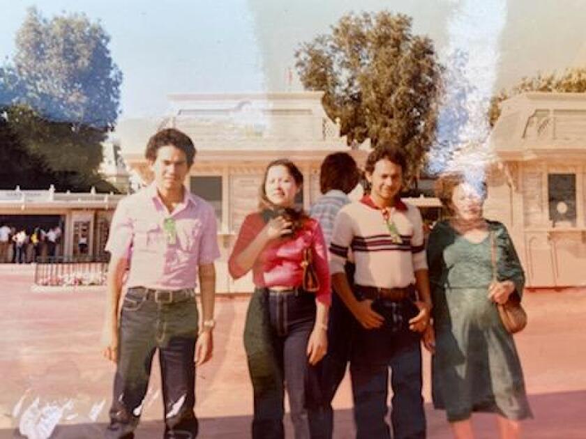 Carlos Ernesto Escobar Mejia with his family at Disneyland