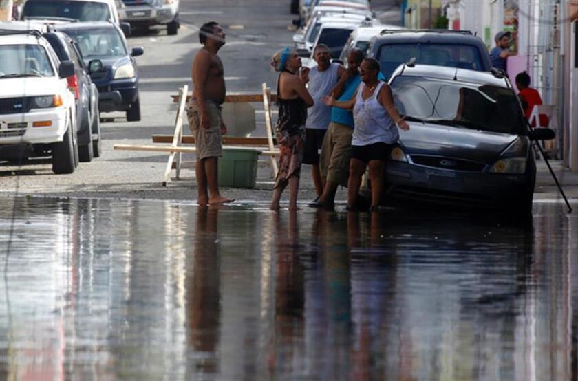 El Servicio Nacional de Meteorología de San Juan emitió hoy una advertencia de inundaciones para nueve municipios de Puerto Rico, específicamente algunos en la zona norte, noreste y este de la isla. EFE/ARCHIVO