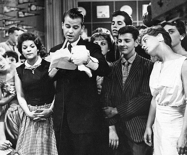 """Dick Clark during a television broadcast of """"American Bandstand"""" in 1957."""