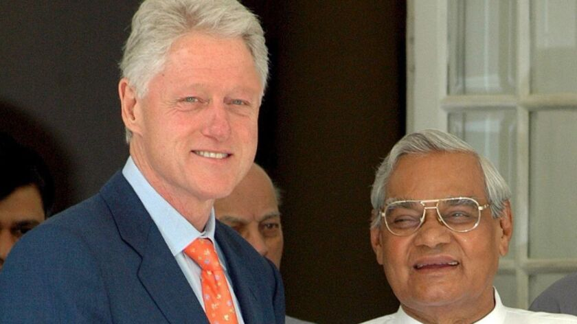 President Clinton shakes hands with former Indian Prime Minister Atal Bihari Vajpayee in New Delhi, India, in 2005.