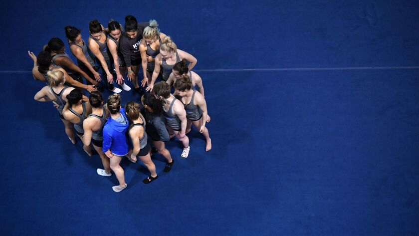LOS ANGELES, CALIFORNIA MARCH 23, 2019-Gymnasts gather before practice at UCLA. (Wally Skalij/Los An
