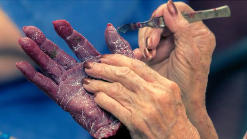 Pat Russell, wife of the late Marine Capt. Hayden Russell, works on a wax mold of her hands at the California Sculpture Academy in Fallbrook on Nov. 19. Russell is a student in the therapeutic Veterans Art Project.