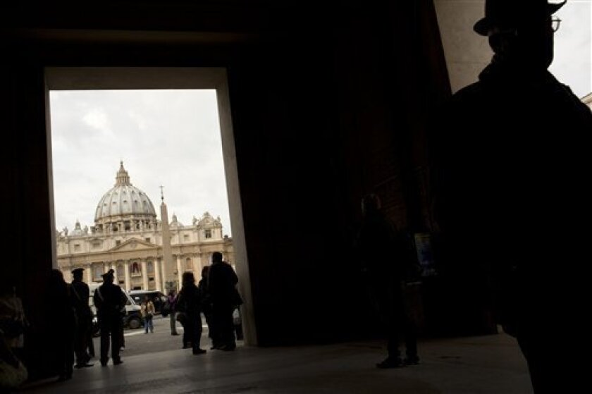 """St. Peter's Basilica is seen in the background as daily life returns to normal two days after Argentine Cardinal Jorge Mario Bergoglio was elected with the name of Pope Francis, Friday, March 15, 2013. Pope Francis has paid a heartfelt tribute to his predecessor Benedict XVI, saying his faith and teaching had """"enriched and invigorated"""" the Catholic Church and would remain its spiritual patrimony forever. (AP Photo/Oded Balilty)"""