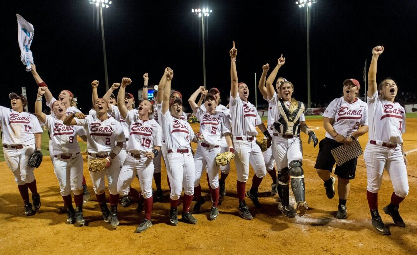 FILE - In this Saturday, May 23, 2015, file photo, Alabama celebrates after a 5-3 win over Oklahoma in an NCAA college softball tournament super regional, in Tuscaloosa, Ala. Alabama has become a regular at the Women's College World Series. (Vasha Hunt/AL.com via AP)