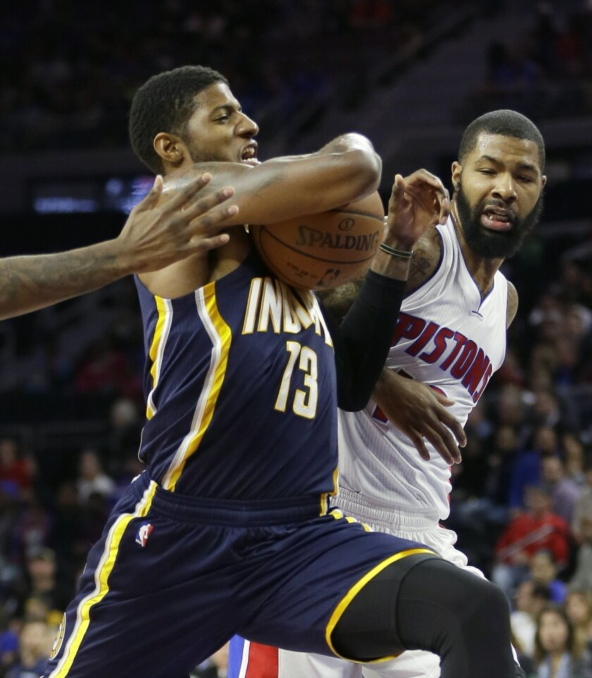 Indiana Pacers forward Paul George (13) drives to the basket as Detroit Pistons forward Marcus Morris defends during the first half of an NBA basketball game, Tuesday, Nov. 3, 2015, in Auburn Hills, Mich., (AP Photo/Carlos Osorio)