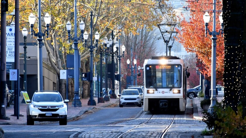 Portland TriMet runs light-rail trains to and from the airport.