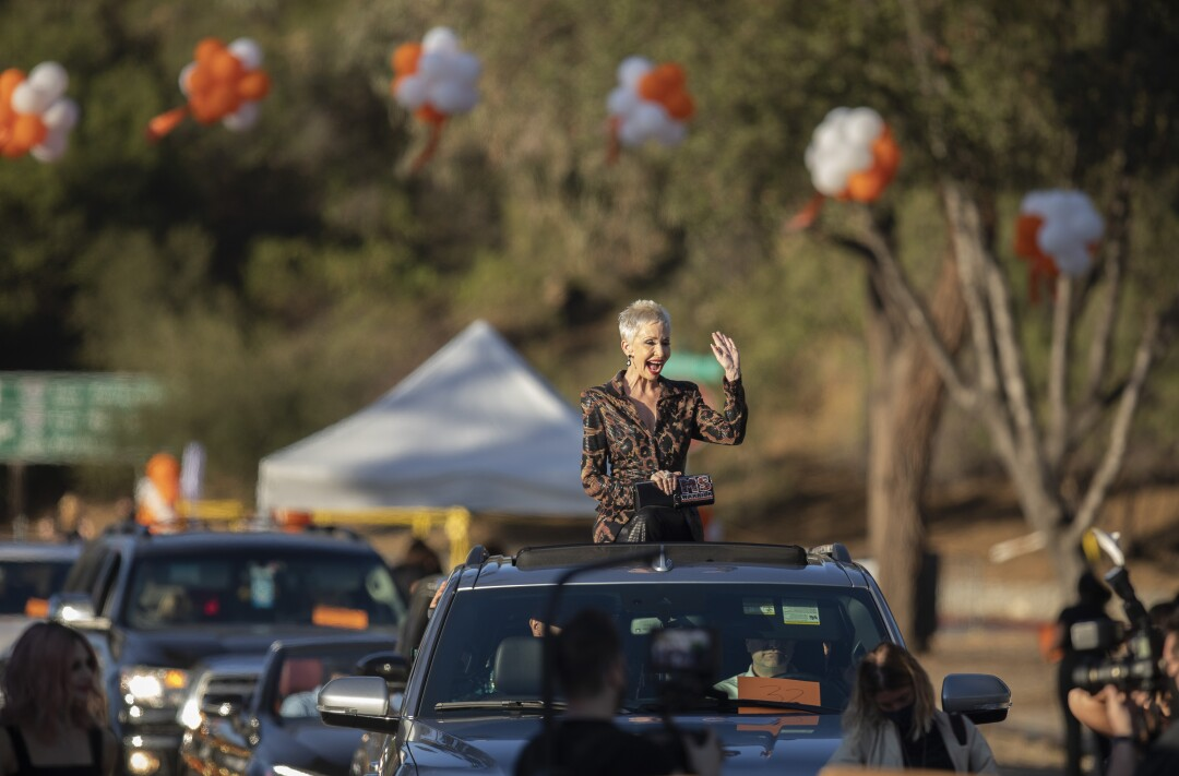 Actress Camerone Parker waves from the sunroof of a car during the arrival for the Race to Erase MS benefit at the Rose Bowl.