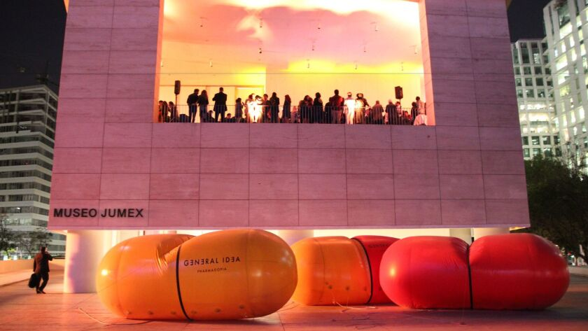 Visitors to the Museo Jumex in Mexico City attend an opening-night party in February above sculpture