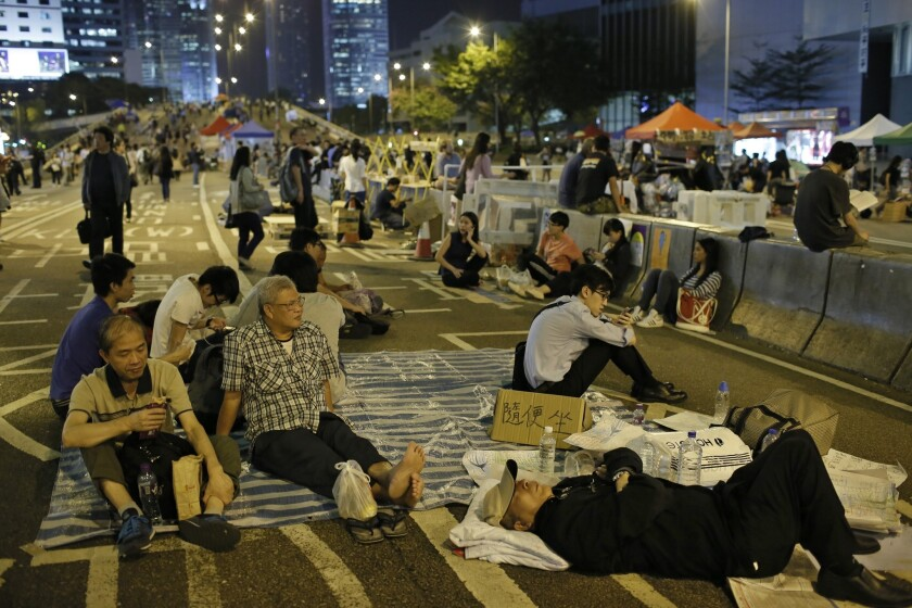 Protesters take a break Oct. 9 in the occupied areas of Hong Kong's central district.