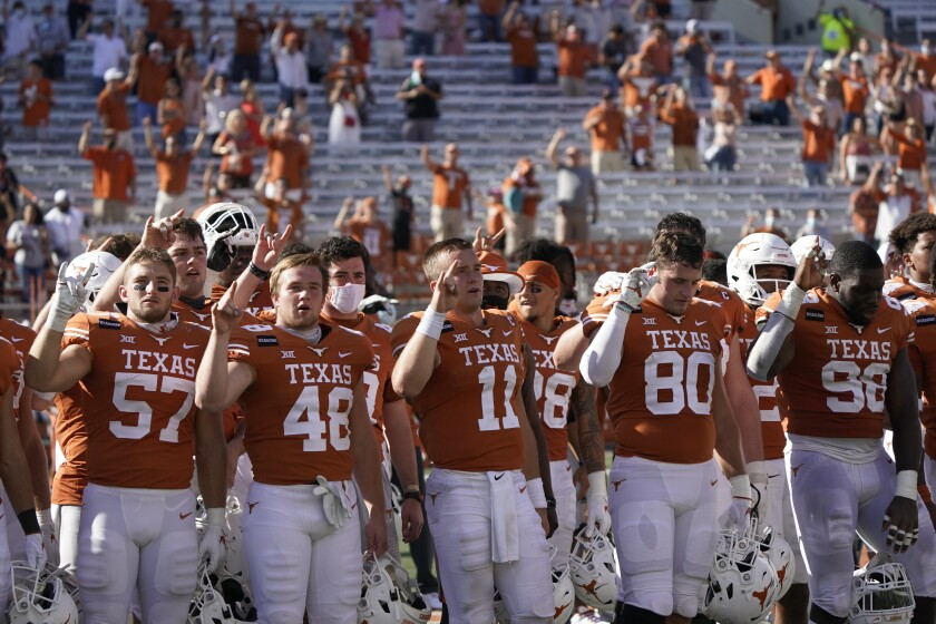 """Texas players sing """"The Eyes of Texas"""" after a game against West Virginia on Nov. 7 in Austin."""