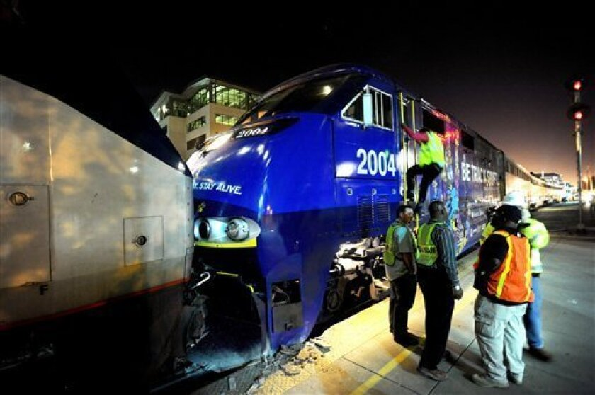 Two Amtrak trains rest against each other after colliding at an Oakland, Calif., station on Wednesday, Oct. 12, 2011. A fire official said one train was unloading passengers when the second train ran into it at an estimated speed of 15 to 20 miles per hour injuring about 16 people. (AP Photo/Noah Berger)