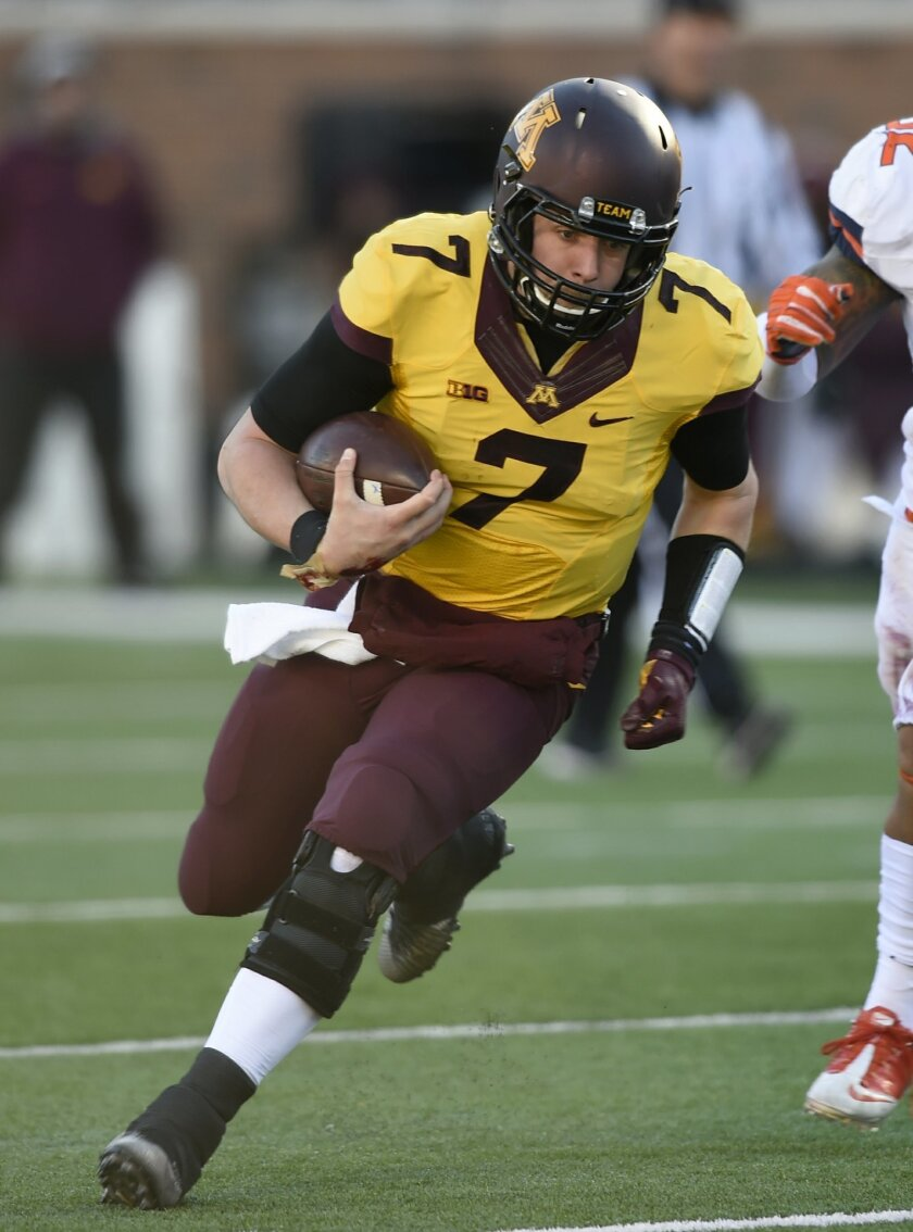 FILE - In this Nov. 21, 2015, file photo, Minnesota's quarterback Mitch Leidner (7) scrambles against Illinois in the first quarter during an NCAA college football game in Minneapolis. Paul Bunyan's Axe is on the line and bowl eligibility for the Gophers _ and both quarterbacks are dealing with injuries. Leidner tweaked his left ankle in last week's win against Illinois and said he was hopeful he would be ready to go. (AP Photo/Hannah Foslien, File)