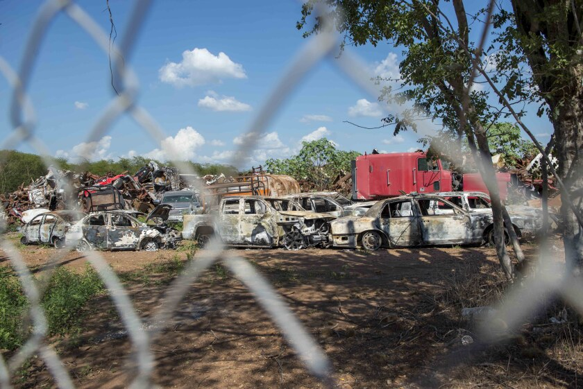 """Charred vehicles riddled with bullets from a recent shootout sit at the attorney general's evidence lot in Culiacan, Mexico, Saturday, Oct. 26, 2019. The physical scars of the Oct. 17 gunbattles _ what's come to be known as """"black Thursday"""" by residents of Culiacan, the capital of Sinaloa and a stronghold of the Sinaloa cartel long led by Joaquín """"El Chapo"""" Guzmán _ are beginning to heal, but residents are still coming to grips with the worst cartel violence in recent memory. (AP Photo/Augusto Zurita)"""