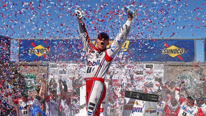 SONOMA, CA - JUNE 25: Kevin Harvick, driver of the #4 Mobil 1 Ford, celebrates in victory lane afte