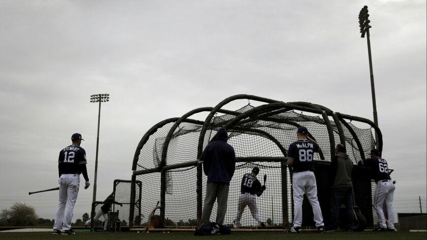 San Diego Padres' Austin Hedges (18) bats during spring training baseball practice Thursday, Feb. 14