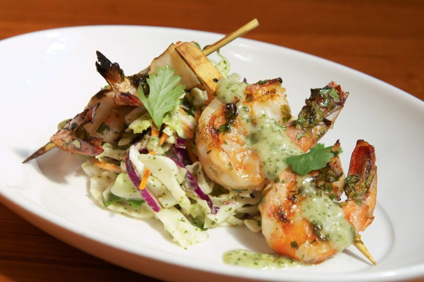 Mesquite grilled Ginger Lime Prawns are covered in cilantro sauce. Photos by Kelley Carlson