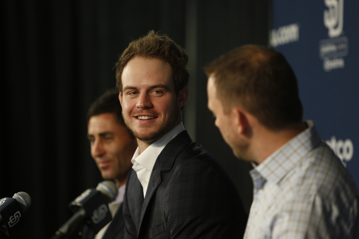 Flanked by team general manager A.J Preller, left, and manager Andy Green, right, Padres infielder Will Myers, center, was all smiles during a press conference to officially announce his six year, 83million dollar contract extension.