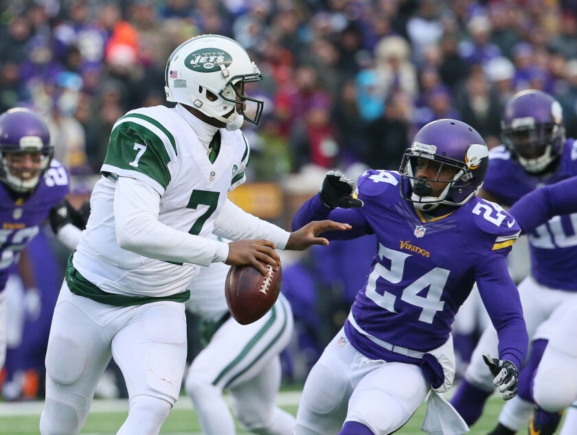 New York Jets quarterback Geno Smith is pressured by Minnesota's Captain Munnerlyn on Dec. 7.