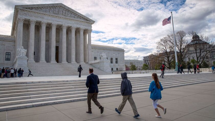Visitors arrive at the Supreme Court. The case before the justices involved two defendants in Colorado.