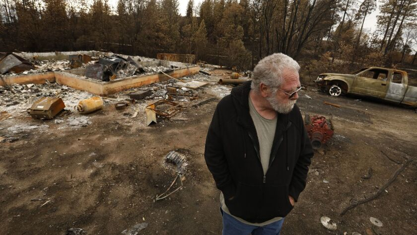 CONCOW, CALIFORNIA--DEC. 4, 2018--Daniel Andrus, 66, visits his property in Concow for the first tim
