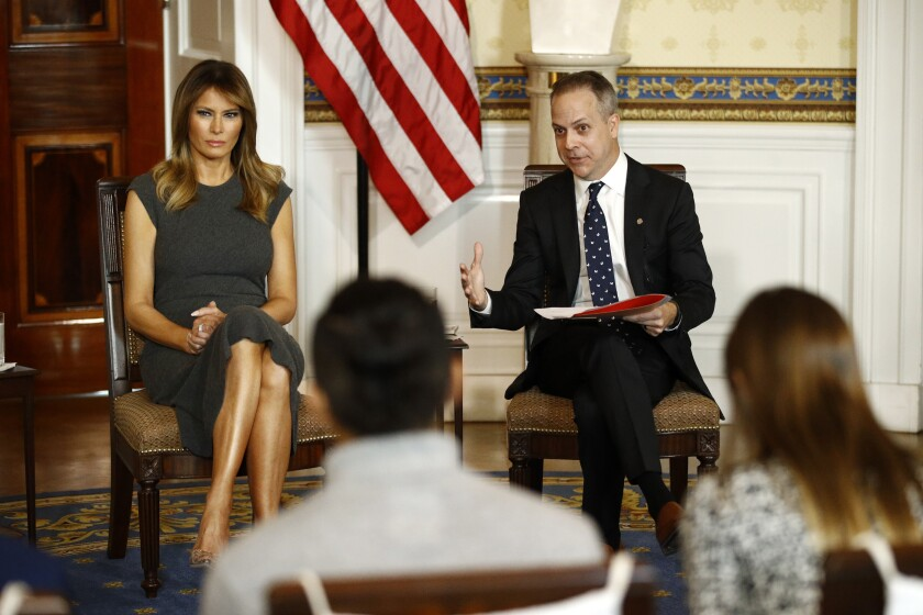 First lady Melania Trump, left, listens as Eric Asche with the Truth Initiative speaks during a listening session with teenagers about their experiences with electronic cigarettes and vaping in the Blue Room of the White House, Wednesday, Oct. 9, 2019, in Washington. (AP Photo/Patrick Semansky)