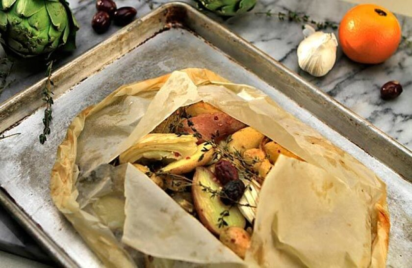 Artichokes, fennel and potatoes bake in a flavorful packet.