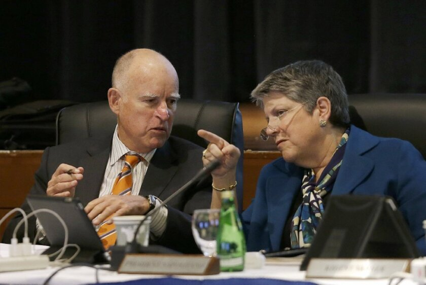 UC President Janet Napolitano talks with Gov. Jerry Brown during a Board of Regents meeting in San Francisco.
